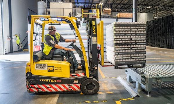 Warehouse Worker Conveyor Belt, netsuite manufacturing