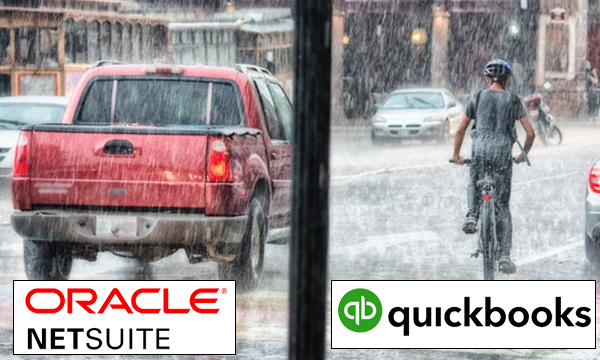 Red truck and bicyclist riding in the rain, NetSuite vs QuickBooks