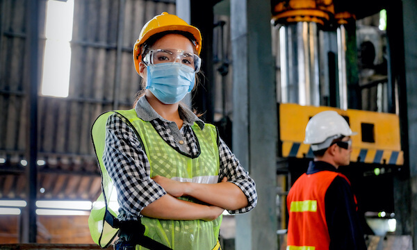 1 Woman with Mask and hardhat in manufacturing facility, NetSuite for manufacturing, netsuite consultants