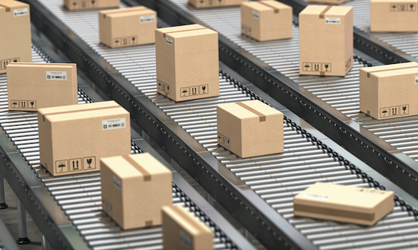 Cardboard boxes on the conveyor belt. Production, storage and delivery concept, netsuite wholesale distribution